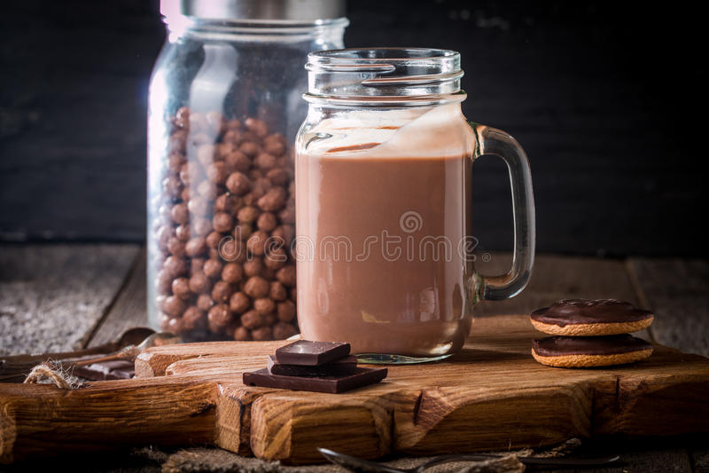 glass of chocolate milkshake for breakfast royalty free stock photography
