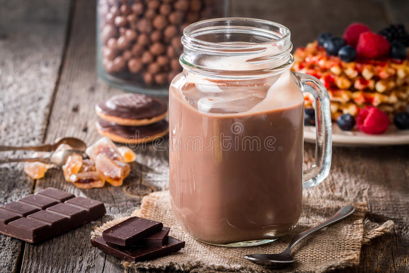 glass of chocolate milkshake for breakfast royalty free stock images