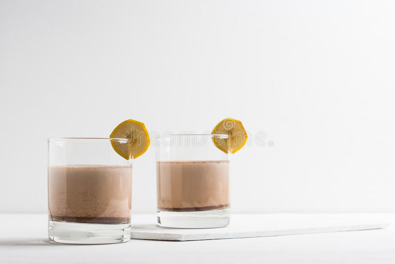 Glass of chocolate milkshake stock photography