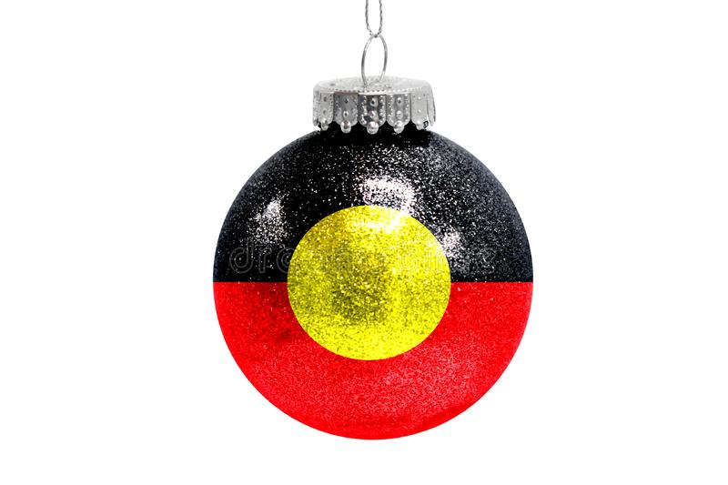 Glass Christmas ball toy isolated on white background with the flag of Australian Aboriginal royalty free illustration