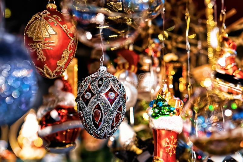 Glass Christmas Tree Decorations in Night Market on Gendarmenmarkt in Winter Berlin, Germany. Advent Fair and Bazaar Stalls with. Craft Items royalty free stock photo