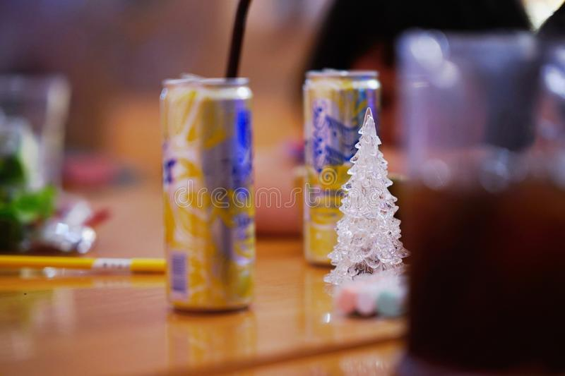 Glass christmas tree in the middle around by party can and beverages royalty free stock images