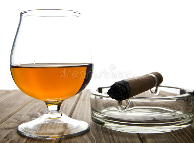 Glass with a cigar royalty free stock photo