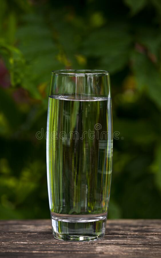 Glass of Clean, clear water on nature background, healthy concept.  royalty free stock photos