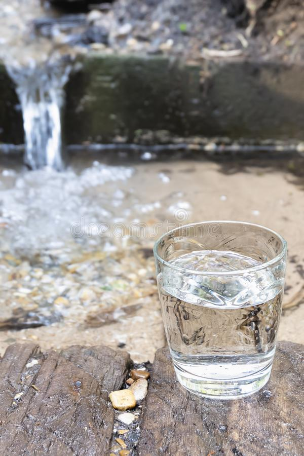 A glass of clean spring water. Source of clean natural water.  stock photography