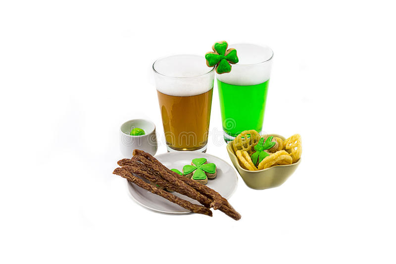 Glass of clover light snack on a white background a spicy evening at the pub. saint Patrick `s Day. Beers in a glass of clover light snack on a white background royalty free stock photos
