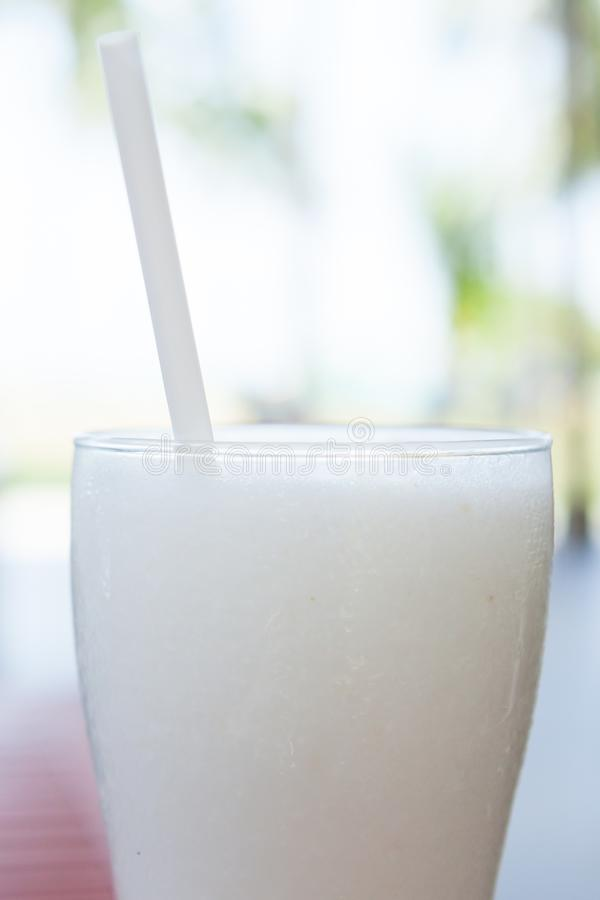 A glass cocktail of coconut ice smoothie. royalty free stock photo