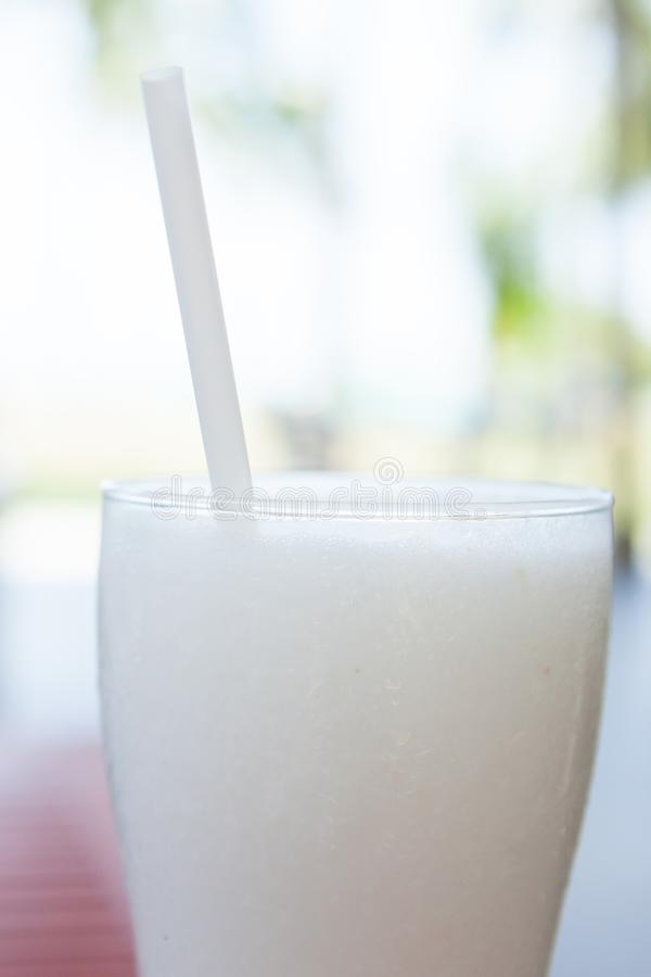 A glass cocktail of coconut ice smoothie. royalty free stock image