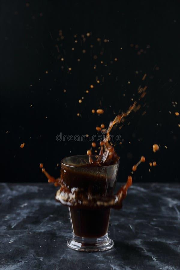 A glass of coffee, coffee splash royalty free stock photo