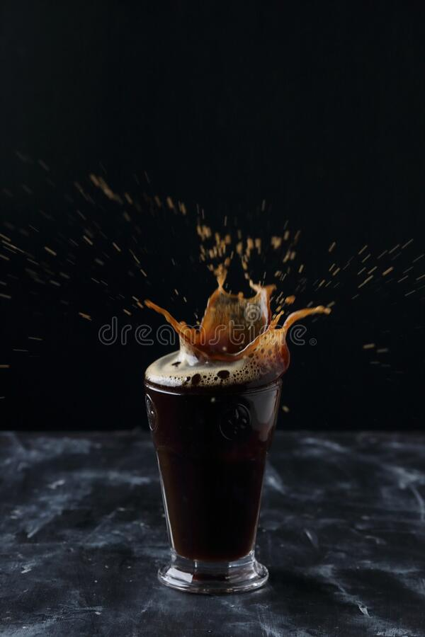 A glass of coffee, coffee splash stock photos