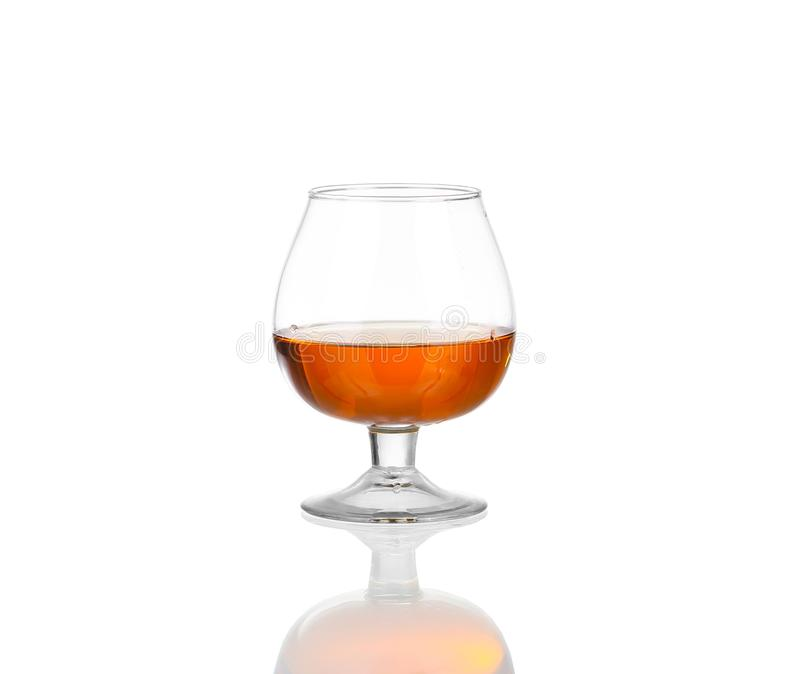Glass of cognac isolated on white. Background stock photography