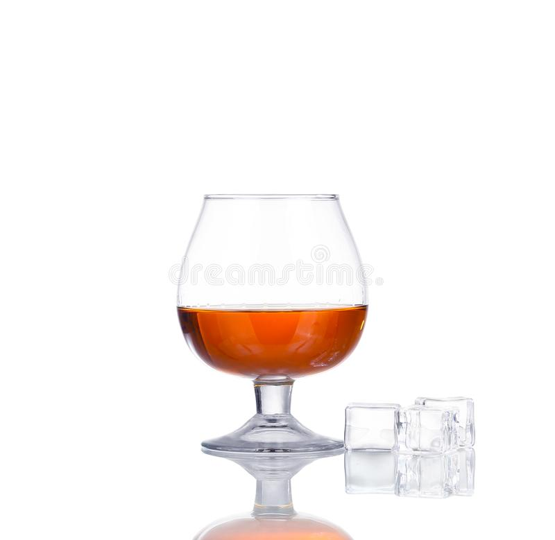 Glass of cognac isolated on white. Background royalty free stock photo