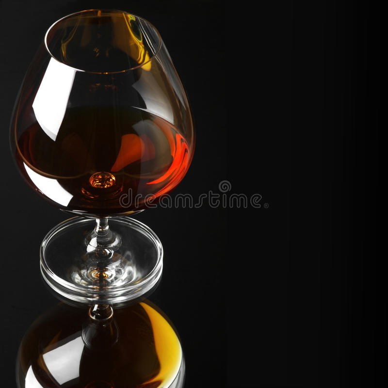 Glass of cognac stock image