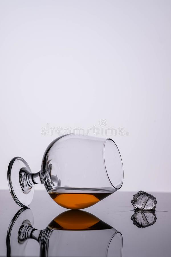 Glass of cognac on on white background. Copy space. Glass of cognac on on white background royalty free stock photos