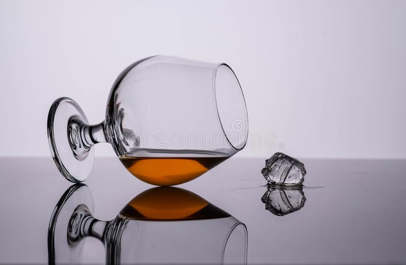 Glass of cognac on on white background. Copy space. Glass of cognac on on white background stock photos