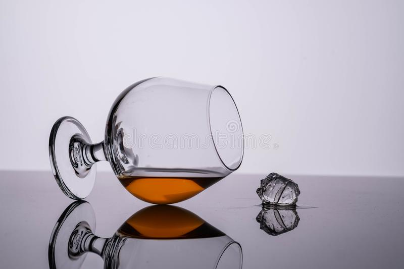 Glass of cognac on on white background. Copy space. Glass of cognac on on white background royalty free stock images