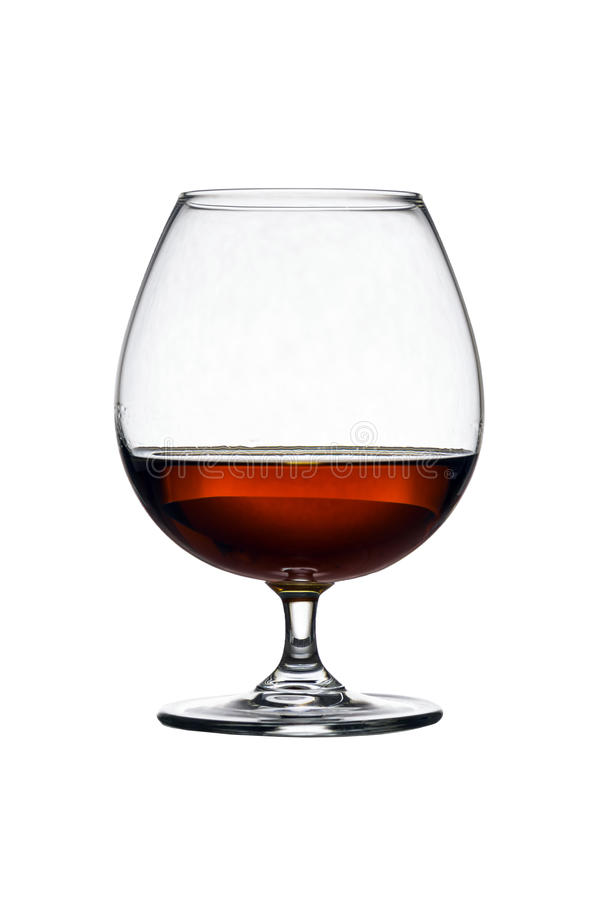 Glass with cognac on white background isolated. Front view. Close up shot. High resolution stock images