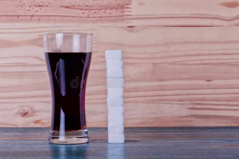 A glass of cola can contain 10 lumps of sugar royalty free stock image
