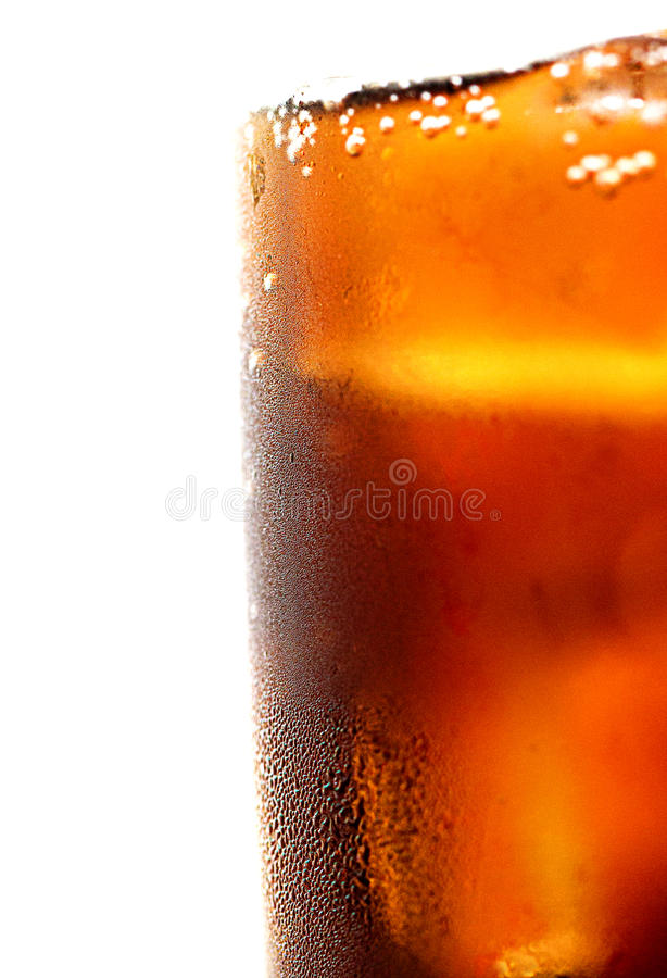 Glass of cola with ice, cold refreshing soft drink with ice on a royalty free stock image