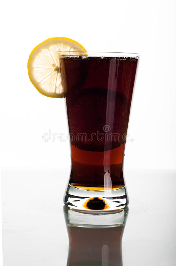Glass of cola with sliced lemon. Photo of cola glass with slices lemon stock photo