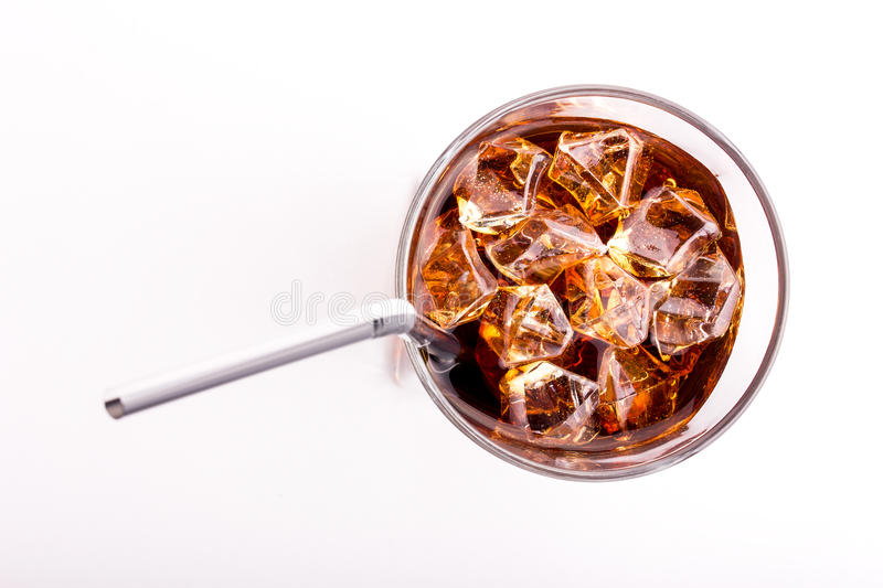 Glass of cola and a straw stock images