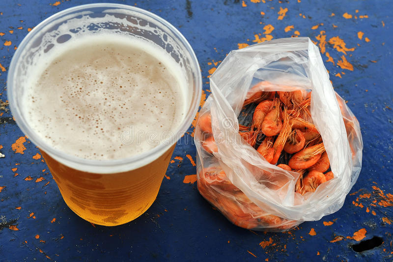 A glass cold beer and seafood royalty free stock photos