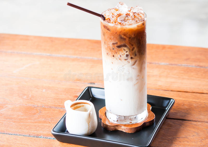 Glass of cold coffee latte with espresso shot royalty free stock photography