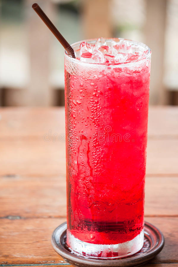 Glass of cold red drink stock images