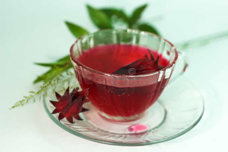 Glass of cold roselle juice - healthy food against wood. royalty free stock photos
