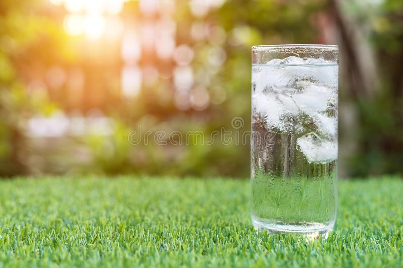 Glass Of Cold Water With Ice On Table With Blur Nature Garden Ba ...