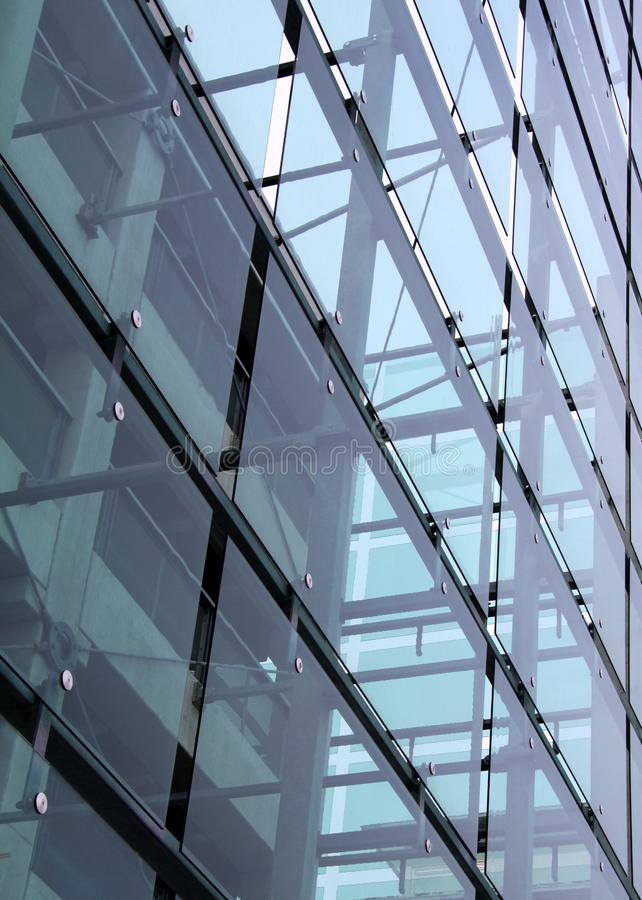 Glass and concrete construction with reflections royalty free stock images