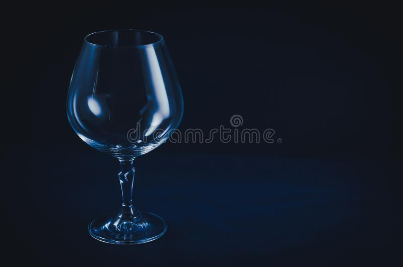 Glass container for alcoholic beverages and the deterioration of the quality of their lives stock image