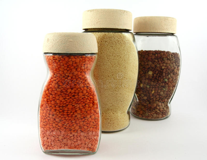 Glass containers with lentils and breadcrumb stock images