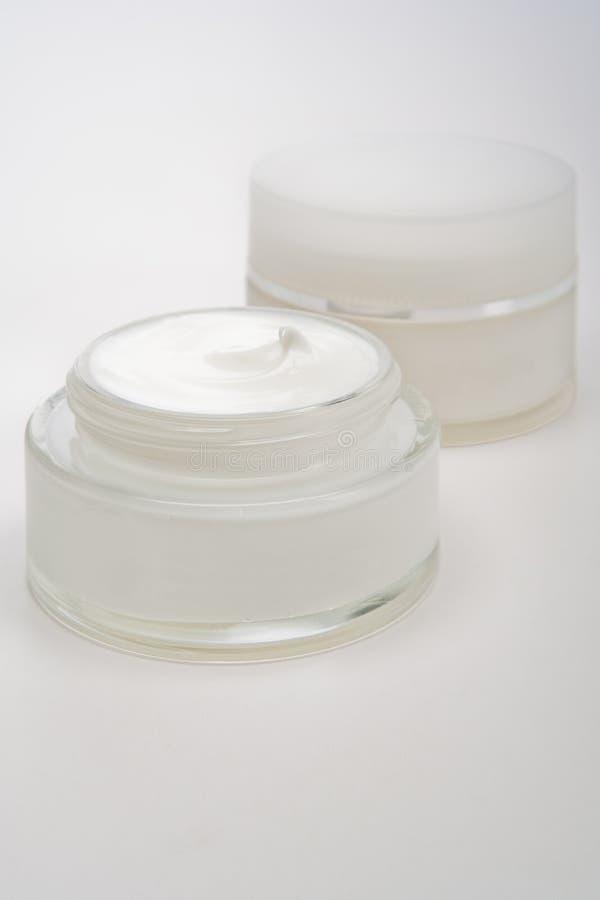 Glass cream jars royalty free stock photo