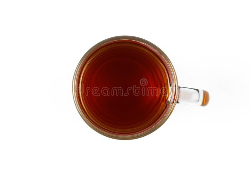 Glass cup of black tea. Close up. Top view. Isolated on white background.  stock image