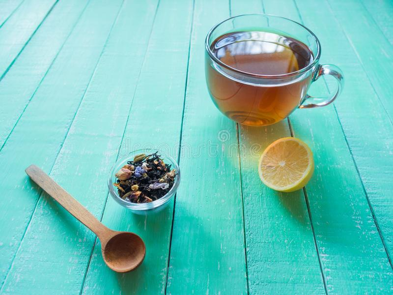 Image result for green and black tea on the blue wooden table