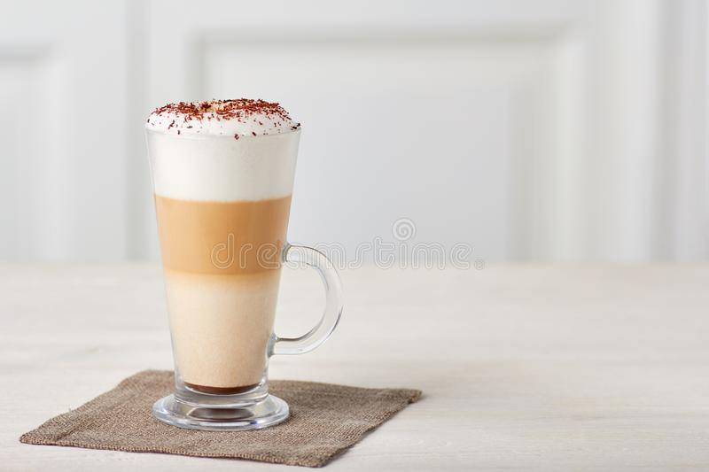 Glass cup of coffee latte on wooden table royalty free stock photos