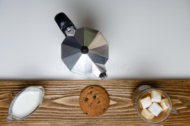 Glass cup of coffee, coffee maker and dessert. View from above royalty free stock photo