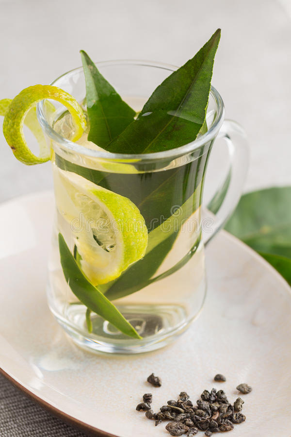 Glass cup of green tea stock photos