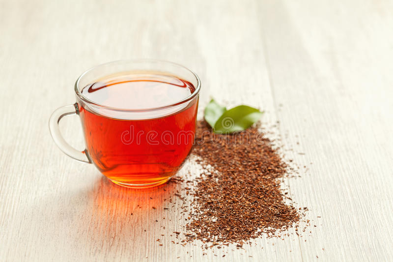 Glass cup of healthy natural herbal rooibos tea on stock photos
