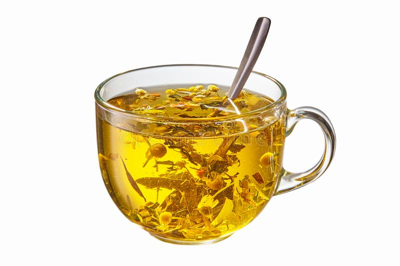 Glass cup of hot herbal tea with spoon stock image