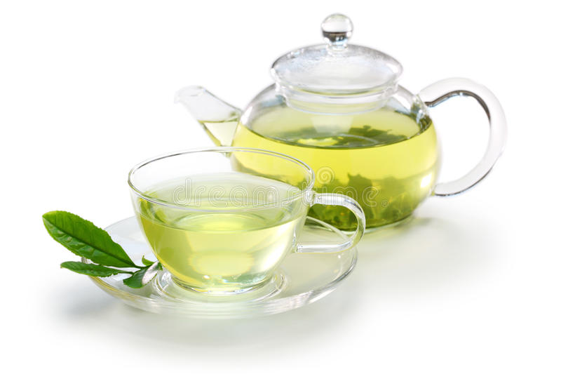 Glass cup of japanese green tea and teapot stock photo