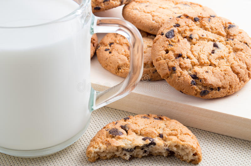 Glass cup with milk and oatmeal cookies with chocolate stock image