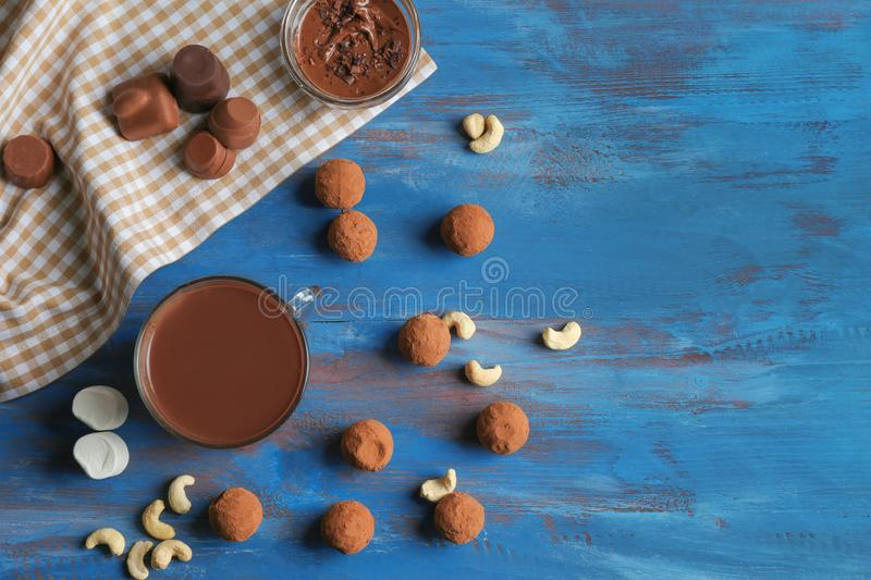 Glass cup of tasty hot chocolate on wooden table royalty free stock photography