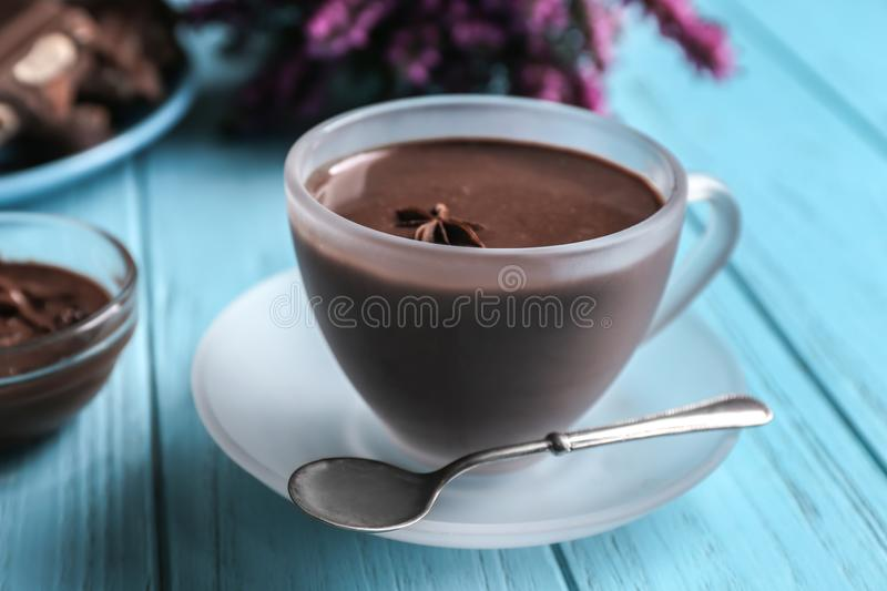 Glass cup of tasty hot chocolate on wooden table royalty free stock photo