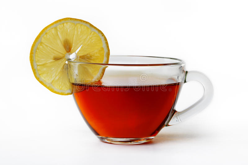 Glass cup of tea with lemon stock images