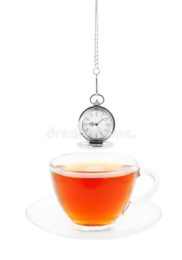 Glass cup of tea and retro watch isolated. On white royalty free stock photos