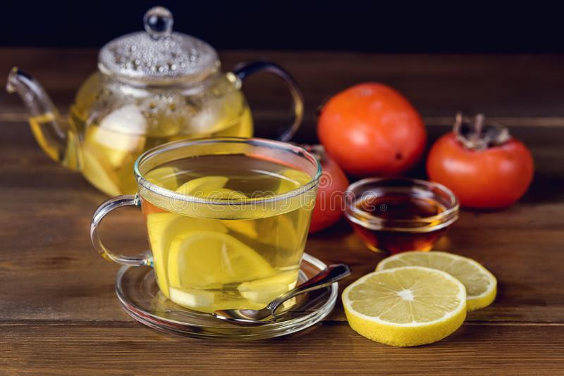 Glass Cup and Glass Teapot with Hot and Tasty Lemon and Ginger Tea Hot Autum Winter Drink Close Up Toned.  stock images