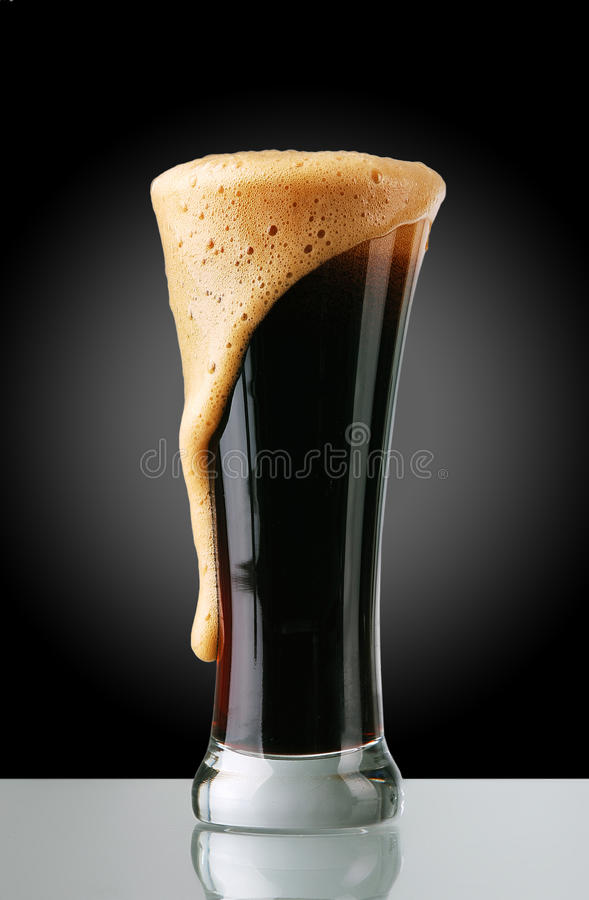 Glass of dark beer royalty free stock photos