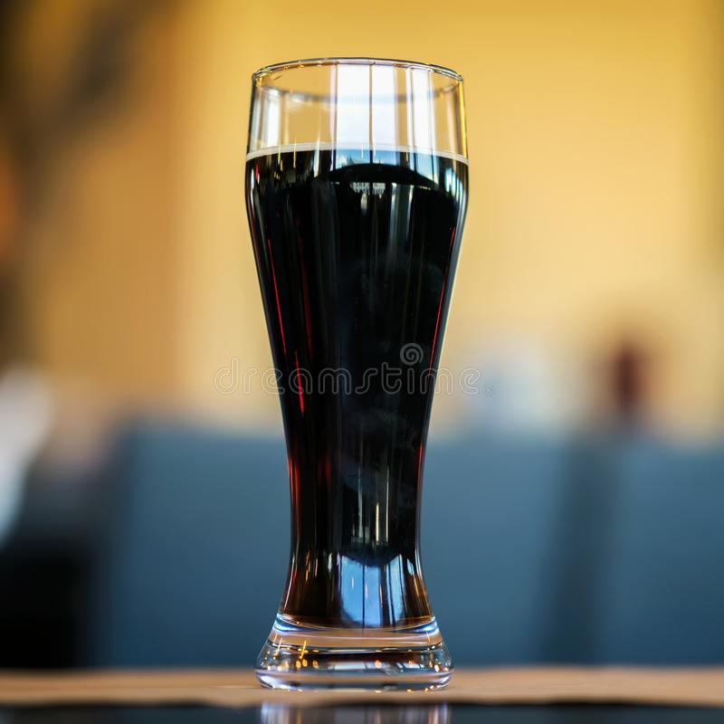 Glass of dark beer in bar or in pub close up. Real scene. Concept of beer culture, Craft brewery, festivals and meetings stock photos